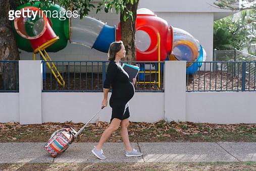 Portrait of mature pregnant female school teacher - gettyimageskorea