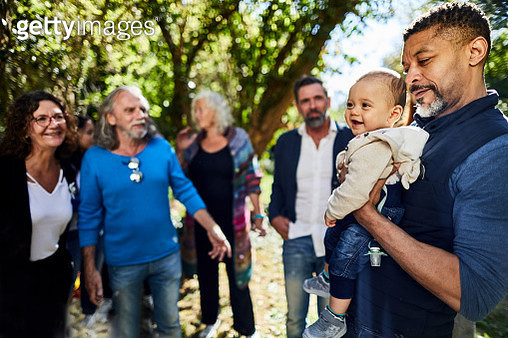 Man holding baby on a garden party - gettyimageskorea