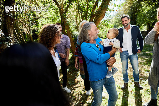 People with baby on a garden party - gettyimageskorea
