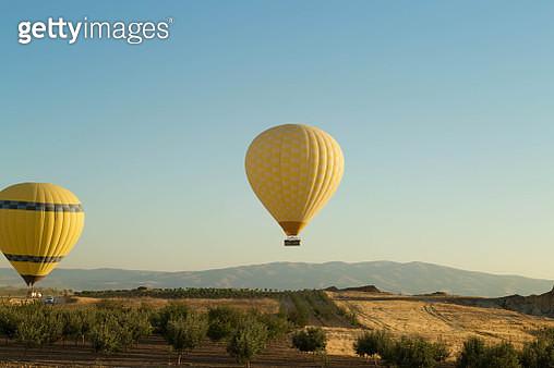 Yellow Hot Air Balloons At Cappadocia - gettyimageskorea
