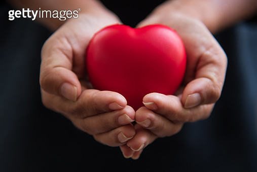 Cropped Hands Of Woman Holding Heart Shape - gettyimageskorea