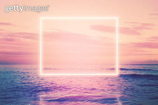 Neon square installation glowing over the sea at sunset. - gettyimageskorea