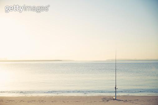 Sunrise fishing and fishing rod on beach - gettyimageskorea