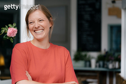 Portrait of laughing young woman in a cafe - gettyimageskorea