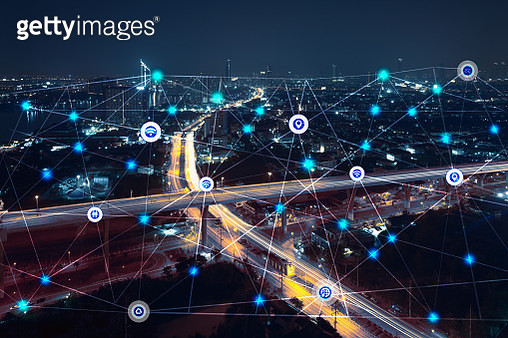 city at night with communication icons and network lines mix media concept background - gettyimageskorea