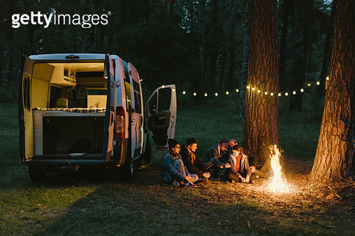 Friends camping near the forest - gettyimageskorea