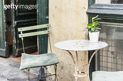 Cozy Danish coffee shop. Small plants decorating a table outside on a summer morning. - gettyimageskorea