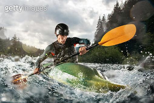 Whitewater kayaking, extreme kayaking. A guy in a kayak sails on a mountain river - gettyimageskorea
