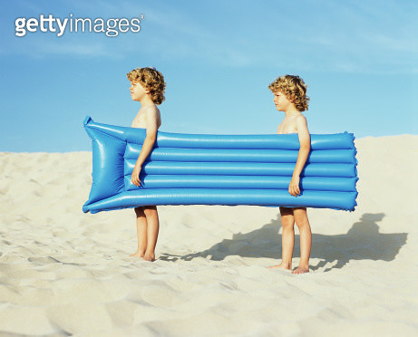 Twin boys carrying an inflatable - gettyimageskorea