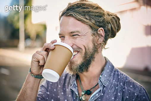Young man with dreadlocks drinking coffee - gettyimageskorea