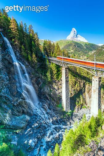 Gornergrat Bahn train on viaduct with Matterhorn on background, Zermatt, canton of Valais, Switzerland - gettyimageskorea