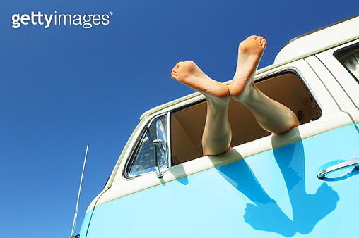 Woman's feet out of window of camper - gettyimageskorea