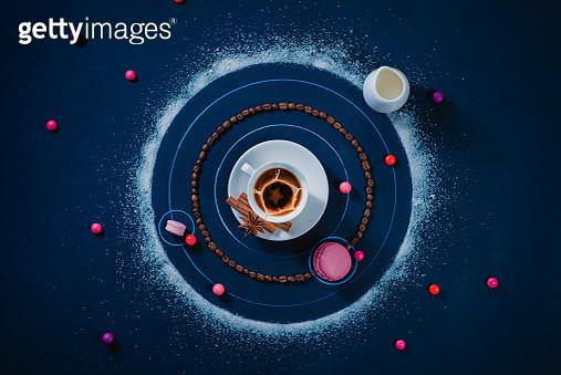 Coffee solar system. A galaxy formed with coffee cup, macaroon cookies, sugar, and candies. Astronomy flat lay, creative food photo. - gettyimageskorea