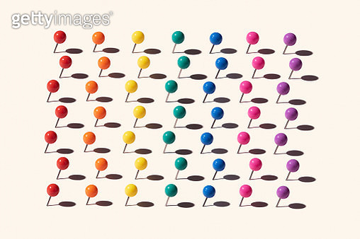 A Variety of Rainbow Colored Straight Pins Pattern on Beige Yellow Background. - gettyimageskorea