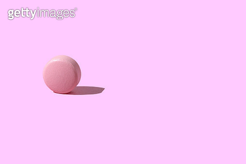 Pink Pill on pink background - gettyimageskorea