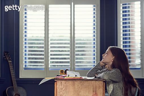 Portrait of girl sitting at desk - gettyimageskorea