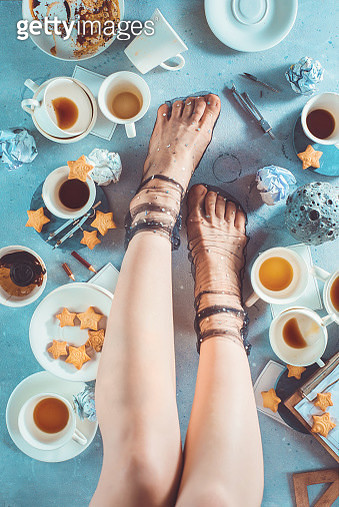Coffee flat lay with legs, star pattern socks, creative drink photography - gettyimageskorea