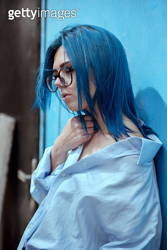 Bold Colours, woman with blue hair in blue shirt near blue wall - gettyimageskorea