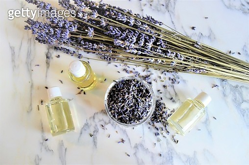 Aromatic oils with lavender flowers on marble background - gettyimageskorea