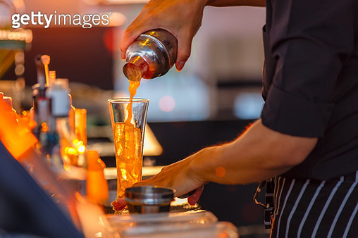 Close up process of preparing a cocktail bartenders from passion fruits - gettyimageskorea