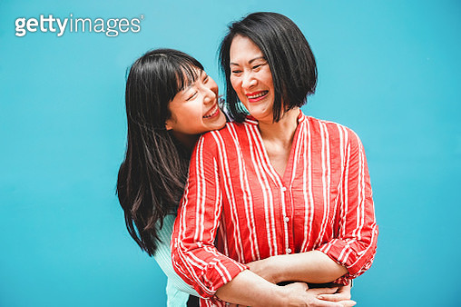 Cheerful Mother And Daughter Against Blue Background - gettyimageskorea