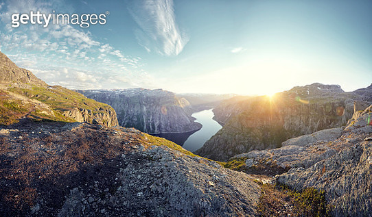 Mountainous landscape and fjord at sunset, Norway - gettyimageskorea
