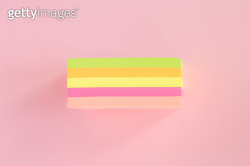 Directly Above Shot Of Colorful Adhesive Notes On Colored Background - gettyimageskorea