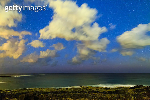 'Stars and clouds in morning twilight over the rocky coast of Fuerteventura, Canary Islands.' - gettyimageskorea