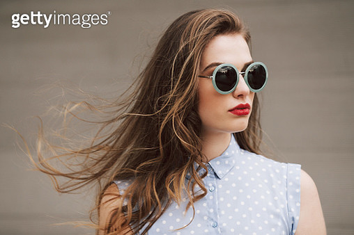 ortrait of a woman with green sunglasses on a windy day - gettyimageskorea