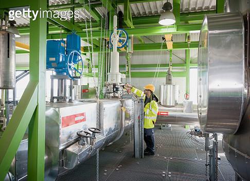 technician on modern power station construction site - gettyimageskorea