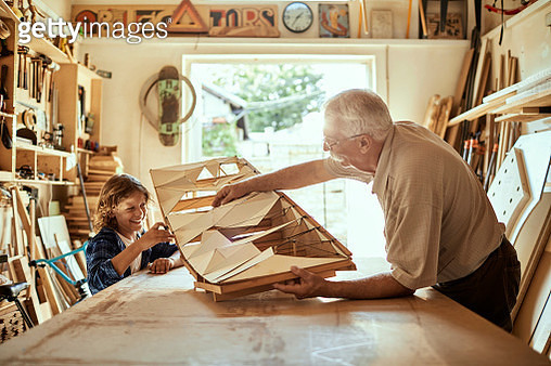 Grandfather and Grandson Working on a Project - gettyimageskorea