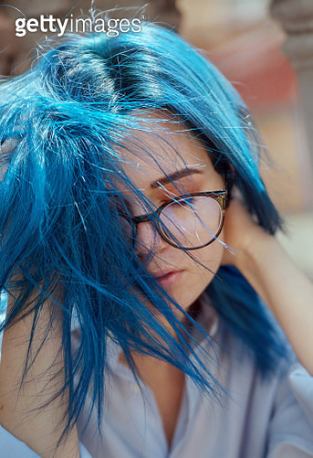 Bold Colours, woman with blue hair in blue shirt in glasses - gettyimageskorea