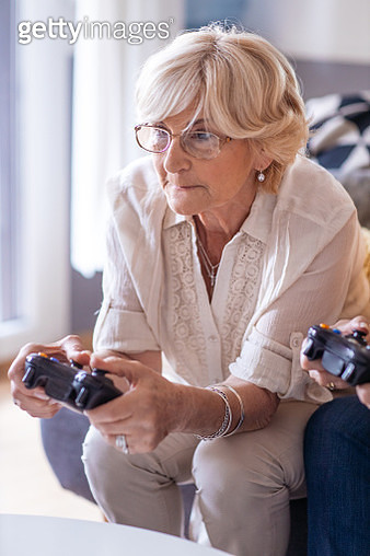 Senior women playing video games together. - gettyimageskorea