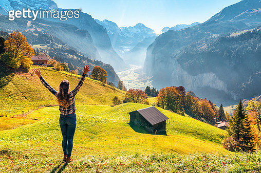 Happy young woman enjoys the view from Wengen - gettyimageskorea