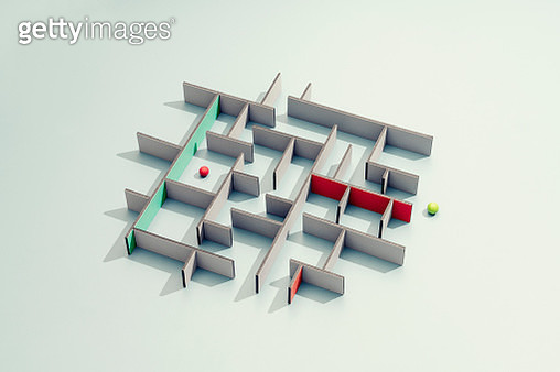 Marbles in a maze, symbolizes people finding their way, a conceptual still life - gettyimageskorea