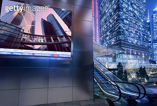 Business district with large billboard display at dusk - gettyimageskorea