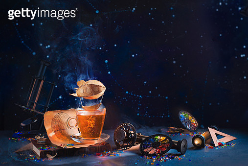 Paper blimp in steam above a teacup with steampunk notes, inventor workplace header - gettyimageskorea
