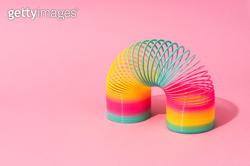 Rainbow Coil Toy on Pink Background. - gettyimageskorea