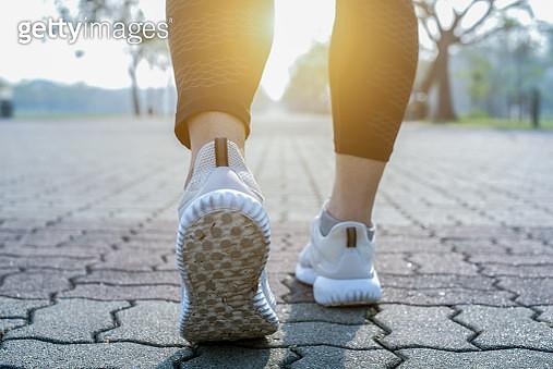 Runner feet running on road closeup on shoe. - gettyimageskorea