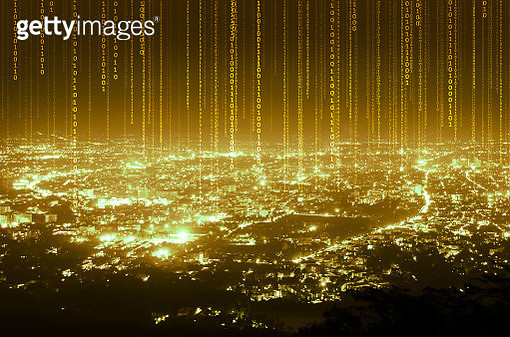 Illuminated Binary Codes Over Cityscape Against Sky At Night - gettyimageskorea