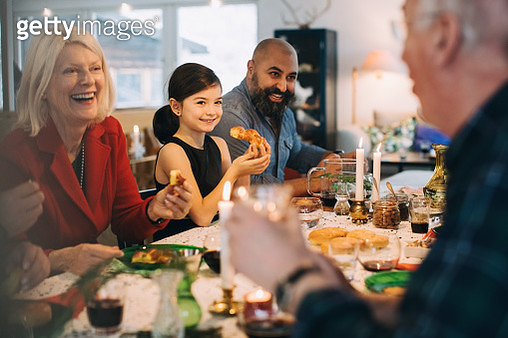 Happy multi-generation family enjoying meal at table during Christmas - gettyimageskorea