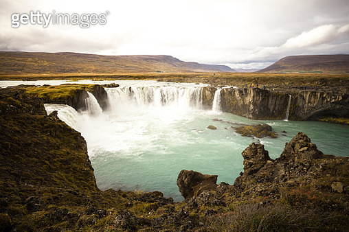 Cold Water In Iceland. Godafoss Waterfall In Rocky Mountains. Fr - gettyimageskorea