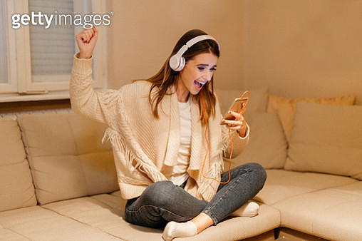 Young woman listening to music - gettyimageskorea