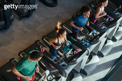 People running on a treadmills in health club - gettyimageskorea