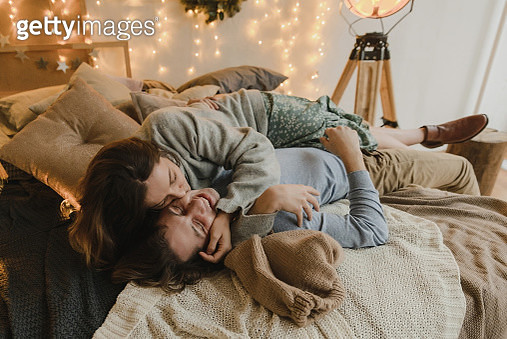 Family couple lying on bed at Christmas - gettyimageskorea