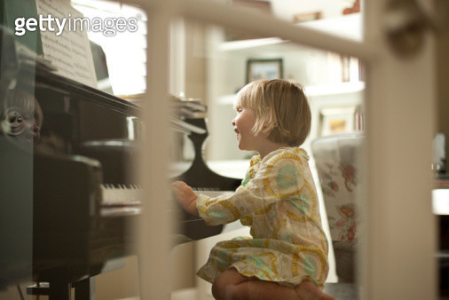 Young girl playing piano - gettyimageskorea