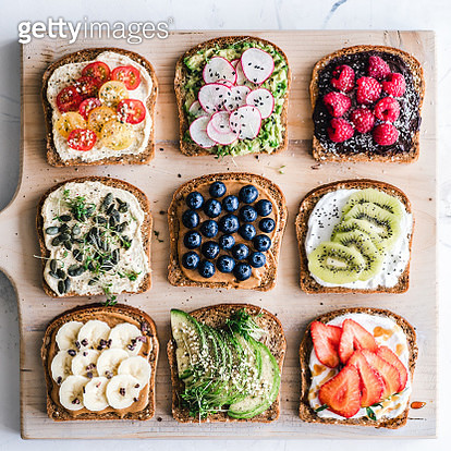 Slices of toast with a variety of healthy toppings - gettyimageskorea