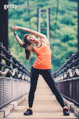 Girl stretching at the bridge - gettyimageskorea