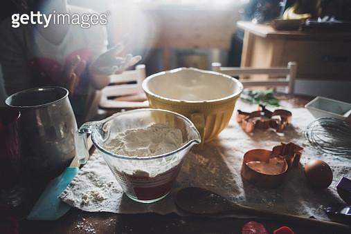 A girl baking cookies. - gettyimageskorea