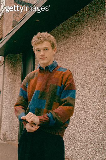 Young caucasian male standing outside wearing a sweater - gettyimageskorea